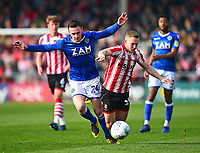 Lincoln City's Danny Rowe is fouled by Macclesfield Town's Michael Rose<br /> <br /> Photographer Andrew Vaughan/CameraSport<br /> <br /> The EFL Sky Bet League Two - Lincoln City v Macclesfield Town - Saturday 30th March 2019 - Sincil Bank - Lincoln<br /> <br /> World Copyright © 2019 CameraSport. All rights reserved. 43 Linden Ave. Countesthorpe. Leicester. England. LE8 5PG - Tel: +44 (0) 116 277 4147 - admin@camerasport.com - www.camerasport.com