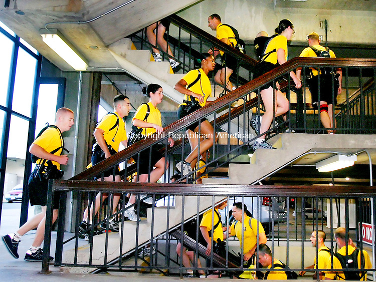 WATERBURY, CT. 11 September 2006--091106SV02--Waterbury Police Cadets run 110 flights of stairs in memory of the police officers and firefighters that died in the World Trade Center on 9-11-01 at the Bank Street garage in Waterbury early Monday morning.<br /> Steven Valenti Republican-American