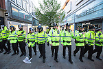 © Joel Goodman - 07973 332324 . 13/05/2013 . Manchester , UK . Police clear Market Street . Police confront 100s of Manchester United fans outside the Manchester City store on Market Street after the Manchester United victory parade , this evening (13th May 2013) Photo credit : Joel Goodman