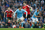 David Silva of Manchester City and Matteo Darmian of Manchester United during the Barclays Premier League match at Old Trafford. Photo credit should read: Philip Oldham/Sportimage