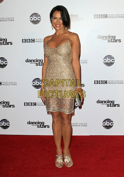 GISELLE FERNANDEZ.'Dancing With The Stars' 200th Episode held at Boulevard 3, Hollywood, CA, USA..November 1st, 2010.full length gold beige dress.CAP/ADM/FS.©Faye Sadou/AdMedia/Capital Pictures.