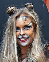 PETA cats pounce on London Fashion Week to celebrate Fur-Free Catwalk.  Following the announcement that this season's London Fashion Week will not showcase any animal fur, a gang of PETA cats strut outside the event to celebrate the fur-free catwalks. <br /> CAP/JOR<br /> &copy;JOR/Capital Pictures