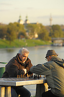 Poland, Krakow, Men playing chess by the Vistula River