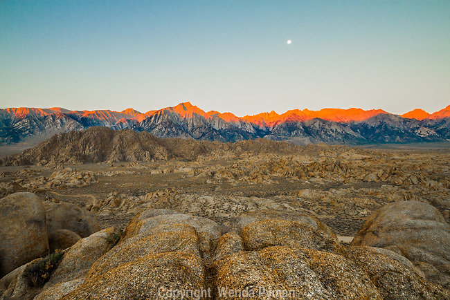 Moonset over the Sierras, while the sunrise adds an orange glow to the mountain range.