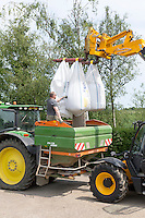 Loading compound nitrogen and sulphur fertilser into a Amazone spreader - Lincolnshire, June