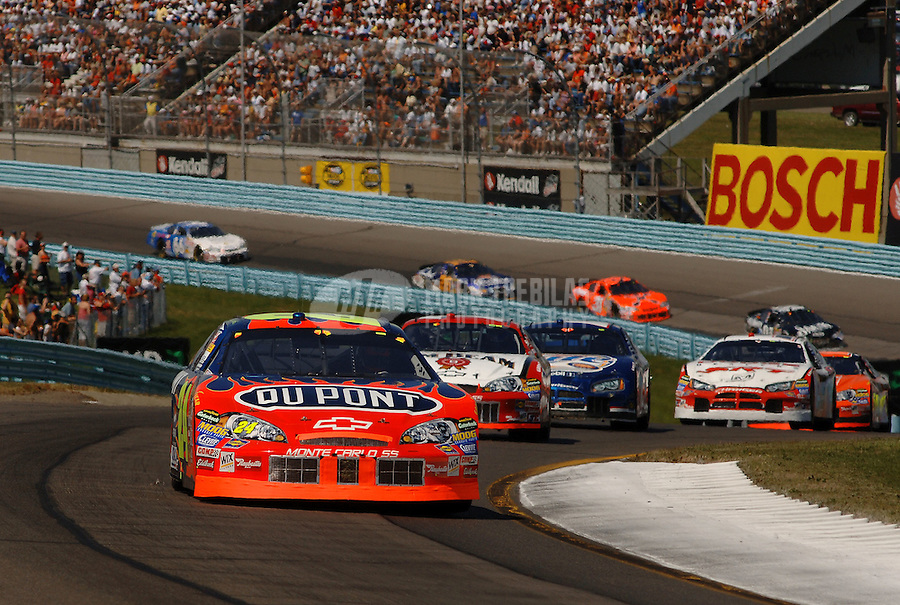Aug. 13, 2006; Watkins Glen, NY, USA; Nascar Nextel Cup driver Jeff Gordon (24) leads Robby Gordon (7) and Kurt Busch (2) during the AMD at the Glen at Watkins Glen International. Mandatory Credit: Mark J. Rebilas