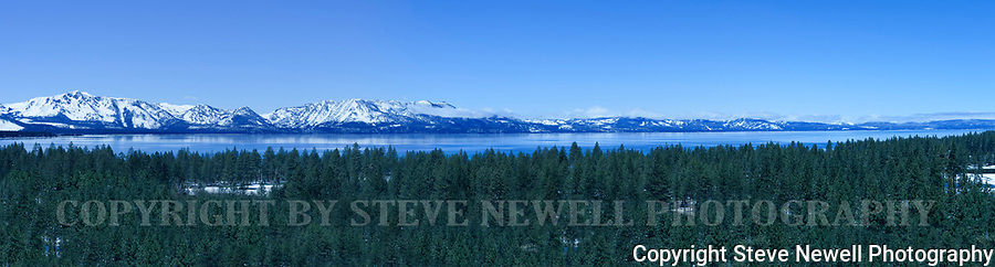 South Lake Tahoe panoramic taken from an elevated view near the Stateline between Nevada and California. We had a few late April snow showers that covered the Tahoe Basin. Everything seems to appear fresh, clean and blue!!!