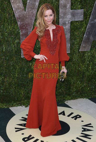 Leslie Mann.2013 Vanity Fair Oscar Party following the 85th Academy Awards held at the Sunset Tower Hotel, West Hollywood, California, USA..February 24th, 2013.oscars full length red rusty orange dress long sleeves hand on hip clutch bag beads beaded .CAP/ADM/SLP/DOW.©Dowling/StarlitePics/AdMedia/Capital Pictures