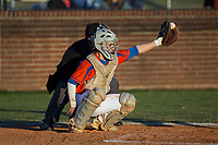 Glenn Bobcats catcher Drew Tiano (1) reaches for a pitch during the game against the Mallard Creek Mavericks at Dale Ijames Stadium on March 22, 2017 in Kernersville, North Carolina.  The Bobcats defeated the Mavericks 12-2 in 5 innings.  (Brian Westerholt/Four Seam Images)