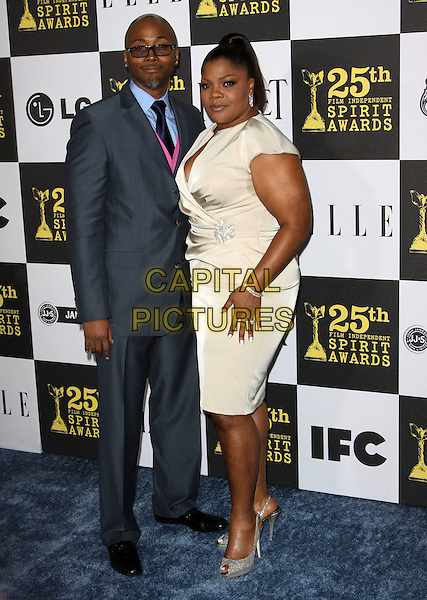 SIDNEY HICKS & MO'NIQUE (MONIQUE IMES).25th Annual Film Independent Spirit Awards held At The Nokia LA Live, Los Angeles, California, USA,.March 5th, 2010 ..arrivals Indie Spirit full length blue grey gray suit shirt pink tie married couple husband wife navy beige gold cream wrap hand peep toe shoes silver slingbacks .CAP/ADM/KB.©Kevan Brooks/Admedia/Capital Pictures