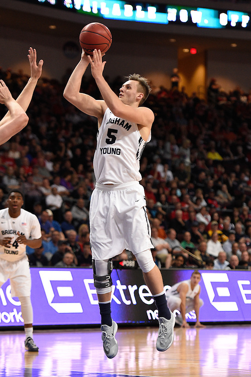 March 9, 2015; Las Vegas, NV, USA; Brigham Young Cougars guard Kyle Collinsworth (5) shoots the basketball against the Portland Pilots during the first half of the WCC Basketball Championships at Orleans Arena.