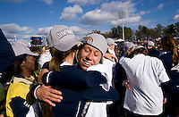 Julie Scheidler (25) of Notre Dame celebrates with teammate Melissa Henderson (6) after the final of the NCAA Women's College Cup at WakeMed Soccer Park in Cary, NC.  Notre Dame defeated Stanford, 1-0.