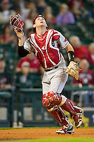Catcher Jake Wise #19 of the Arkansas Razorbacks tracks a foul pop fly against the Houston Cougars at Minute Maid Park on March 3, 2012 in Houston, Texas.  The Cougars defeated the Razorbacks 4-1.  Brian Westerholt / Four Seam Images