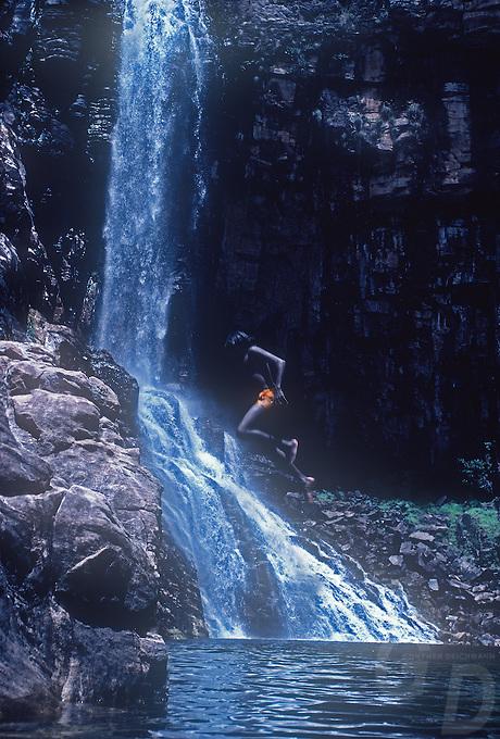 Aboriginal Children playing at a Waterfall in Arnhem Land,Northern Territory, Australia