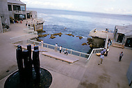 December 11, 1984 - Monterey Bay, California. View of the Monterey Bay Aquarium. The Monterey Bay Aquarium, located on Cannery Row of the Pacific Ocean in Monterey California, was founded in 1984 and holds thousands of plants and animals. The annual attendance of the aquarium is 1.8 million visitors.
