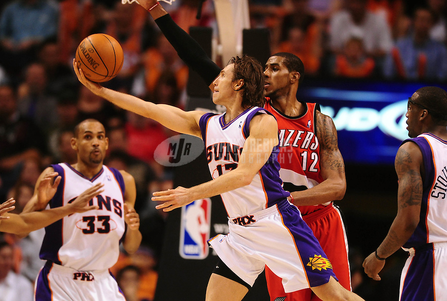 Apr. 20, 2010; Phoenix, AZ, USA; Phoenix Suns guard (13) Steve Nash takes a shot under pressure from Portland Trail Blazers forward (12) LaMarcus Aldridge in the second half of game two in the first round of the 2010 NBA playoffs at the US Airways Center. Phoenix defeated Portland 119-90. Mandatory Credit: Mark J. Rebilas-
