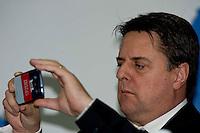 Roma 1 Marzo 2014<br /> Riunione  dei partiti dell'ultradestra europea  per un convegno dal titolo &ldquo;L&rsquo;Europa Risorge&rdquo;. L'eurodeputato del British National Party Nicolas Griffin, fotografa il convegno con lo smartphone<br /> Rome, March 1, 2014<br /> Meeting of the ultra-right European parties for a conference entitled &quot;Europe is resurrects .&quot;  The British National Party MEP Nicholas Griffin, photographing the conference with your smartphone