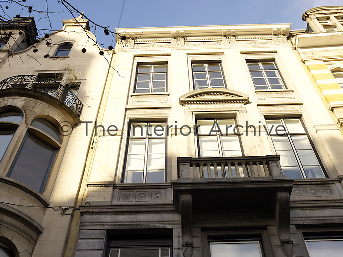 The stone town house dates from 1907 and is located on a grand boulevard in central Brussels