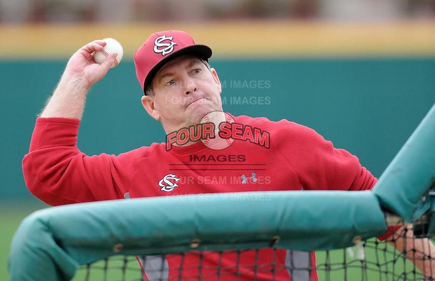 Head coach Ray Tanner (1) throws batting practice for the University of South Carolina Gamecocks team on January 20, 2012, at Carolina Stadium in Columbia, South Carolina. Tanner's Gamecocks have won back-to-back College World Series championships. (Tom Priddy/Four Seam Images)