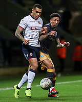 Bolton Wanderers' Josh Magennis competing with Sheffield Wednesday's Liam Palmer <br /> <br /> Photographer Andrew Kearns/CameraSport<br /> <br /> The EFL Sky Bet Championship - Bolton Wanderers v Sheffield Wednesday - Tuesday 12th March 2019 - University of Bolton Stadium - Bolton<br /> <br /> World Copyright © 2019 CameraSport. All rights reserved. 43 Linden Ave. Countesthorpe. Leicester. England. LE8 5PG - Tel: +44 (0) 116 277 4147 - admin@camerasport.com - www.camerasport.com