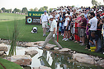 Dubai World Championship Golf. Earth Course,.Jumeirah Golf Estate, Dubai, U.A.E...Padraig Harrington walks round where his ball lies in the water in the 18th during the second round of the Dubai World Golf championship..Photo: Fran Caffrey/www.golffile.ie...