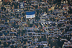 Home fans in the Ostkurve section of the stadium, which housed the majority of the 14,714 crowd, waving flags and scarves before Hertha Berlin's match against  Sporting Lisbon at the Olympic Stadium in Berlin in the group stages of the UEFA Europa League. Hertha won the match by 1 goal to nil to press to the knock-out round of the cup. 2009/10 was the the first year in which the Europa League replaced the UEFA Cup in European football competition.