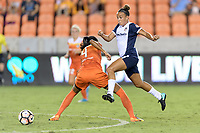 Houston, TX - Saturday July 15, 2017: Mallory Pugh jumps over Bruna Benites while chasing after the ball during a regular season National Women's Soccer League (NWSL) match between the Houston Dash and the Washington Spirit at BBVA Compass Stadium.
