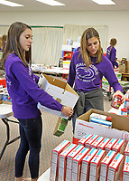 Guerin students helped fill food boxes at St. Maria Goretti for distribution at Thanksgiving.  (L-R) Gabriela Peabody and Grace Mehne.