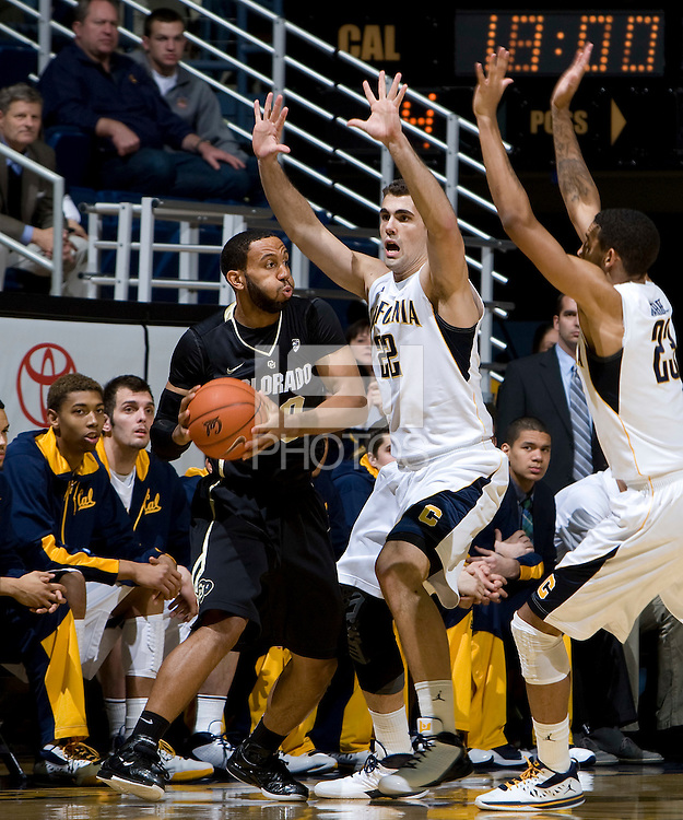 Harper Kamp of California tries to block Carlon Brown of Colorado during the game at Haas Pavilion in Berkeley, California on January 12th, 2012.   California defeated Colorado, 57-50.