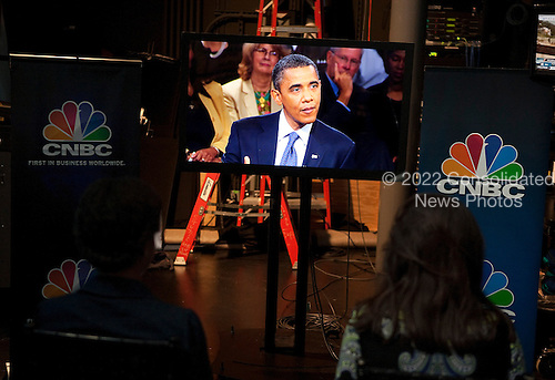 Members of the White House press pool watch United States President Barack Obama speaking on a television monitor during a town hall discussion on jobs and the economy hosted by CNBC at the Newseum in Washington, D.C., U.S., on Monday, September 19, 2010. .Credit: Joshua Roberts - Pool via CNP