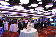 Conference attendees networking.