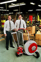 FILE: Mark R. Pfeiffer, Executive Vice President, and his brother Norman S. Pfeiffer, President of Schiller-Pfeiffer, stand in the wharehouse of their Southampton business that manufactures Mantis Lawn and Garden Power Equipment, Oct. 16, 1997. In front of them is an edger and a blower.   (Photo by William Thomas Cain)