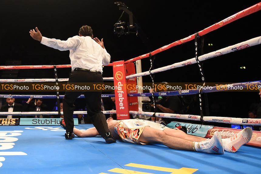 JJ McDonagh (white/gold shorts) defeats Jake Ball during a Boxing Show at the SSE Arena, Wembley on 26th November 2016
