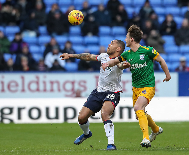 Bolton Wanderers' Josh Magennis competing with Preston North End's Ben Davies  <br /> <br /> Photographer Andrew Kearns/CameraSport<br /> <br /> The EFL Sky Bet Championship - Bolton Wanderers v Preston North End - Saturday 9th February 2019 - University of Bolton Stadium - Bolton<br /> <br /> World Copyright © 2019 CameraSport. All rights reserved. 43 Linden Ave. Countesthorpe. Leicester. England. LE8 5PG - Tel: +44 (0) 116 277 4147 - admin@camerasport.com - www.camerasport.com