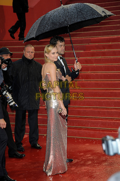 Diane Kruger, Joshua Jackson.'Amour' screening at the 65th  Cannes Film Festival, France..20th May 2012.full length silver gold sequins sequined strapless dress side profile tuxedo umbrella couple .CAP/PL.©Phil Loftus/Capital Pictures.