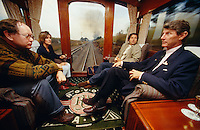 Rovos Rail owner Rohan Vos (r.) talking with passengers at the observation car.