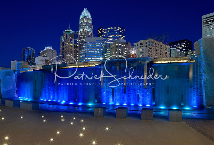 Romare Bearden Park  - The Charlotte NC skyline rises up out of the Romare Bearden Park in Uptown Charlotte's Third Ward .Buildings shown in photo include the  Wells Fargo buildings (middle), Bank of America tower and Hearst Tower. Romare Bearden Park is a 5.4-acre public park located at 300 S. Church Street in Charlotte, North Carolina.<br /> Charlotte Photographer - PatrickSchneiderPhoto.com