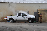 Eric Larson, Parks and Recreation employee, washing his truck in the manual washing area Thursday Feb. 6, 2020 at Fayetteville's fleet wash facility on Happy Hollow Rd. The city plans to start construction of a $1.3 million fleet wash facility next month. (NWA Democrat-Gazette/J.T. Wampler)