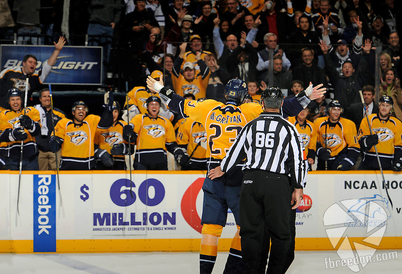 NASHVILLE, TN - NOVEMBER 17:  Fans and players react to Brian McGrattan of the Nashville Predators after a fight against a member of the Toronto Maple Leafs of the  at Bridgestone Arena on November 17, 2011 in Nashville, Tennessee.  (Photo by Frederick Breedon/Getty Images)