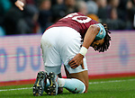 Tyrone Mings of Aston Villa holds his hamstring before going off injured during the Premier League match against Leicester City at Villa Park, Birmingham. Picture date: 8th December 2019. Picture credit should read: Darren Staples/Sportimage