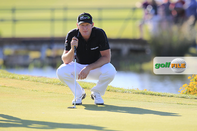 Jamie Donaldson (WAL) on the 14th green during Sunday's Final Round of the 2013 Portugal Masters held at the Oceanico Victoria Golf Club. 13th October 2013.<br /> Picture: Eoin Clarke/www.golffile.ie