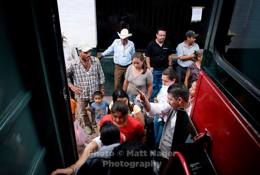 A crowd rushes to board the Economy train at the Bahuichivo train stop in Copper Canyon, Mexico, Friday, June 20, 2008. There are two classes of train riding the Chihuahua Pacific Railway, Economic and First Express...PHOTOS/ MATT NAGER