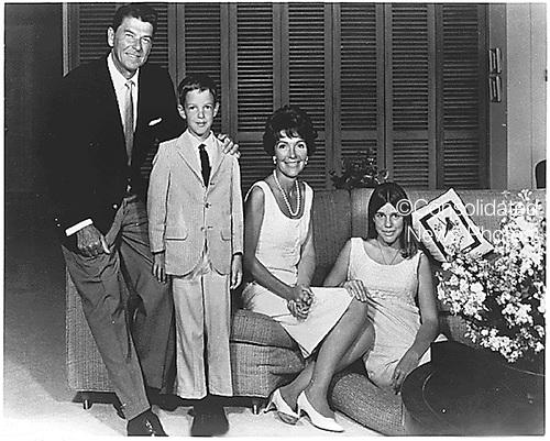 Photograph of Governor Ronald Reagan (Republican of California), Ron Reagan, Junior, Mrs. Nancy Reagan, and Patti Davis circa 1967..