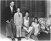 Photograph of Governor Ronald Reagan (Republican of California), Ron Reagan, Junior, Mrs. Nancy Reagan, and Patti Davis circa 1967..