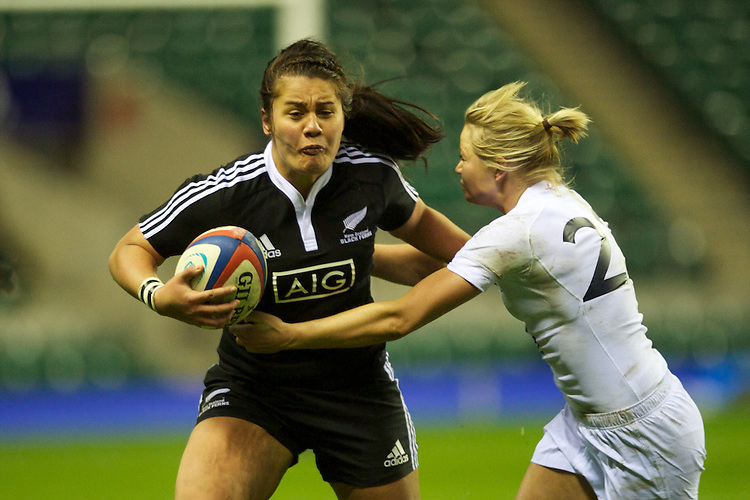 Shakira Baker of the Black Ferns is tackled by Francesca Matthews of England Women during the test match between England Women and the Black Ferns at Twickenham on Saturday 01 December 2012 (Photo by Rob Munro)