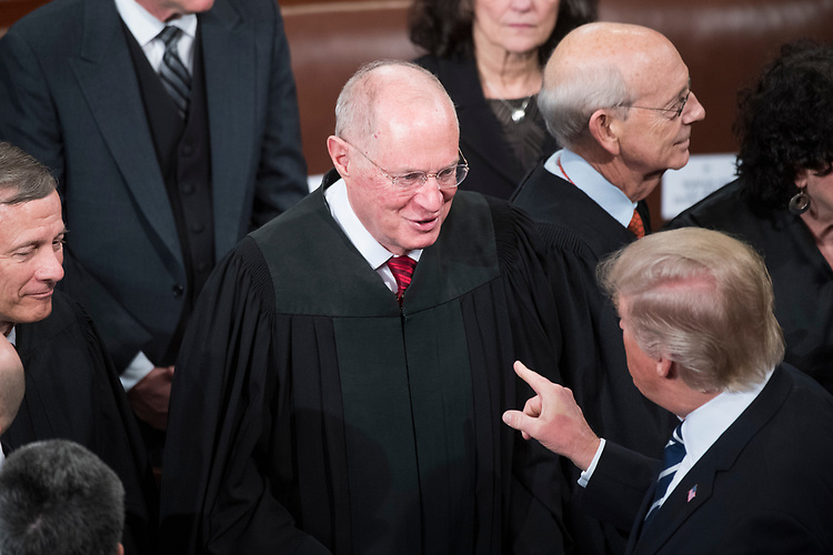 UNITED STATES - FEBRUARY 28: President Donald Trump greets Supreme Court Justice Anthony Kennedy after addressing a joint session of Congress in the Capitol's House Chamber, February 28, 2017. (Photo By Tom Williams/CQ Roll Call)