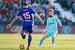 Lionel Andres Messi (r) of FC Barcelona tackles Diego Rico Salguero of CD Leganes during the La Liga 2017-18 match between CD Leganes vs FC Barcelona at Estadio Municipal Butarque on November 18 2017 in Leganes, Spain. Photo by Diego Gonzalez / Power Sport Images