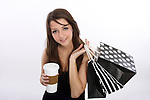 A young woman with coffee mug and shopping bags