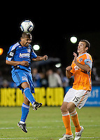 Geovanni (left) heads the ball against Cam Weaver (15). The Houston Dynamo defeated the San Jose Earthquakes 1-0 at Buck Shaw Stadium in Santa Clara, California on October 16th, 2010.