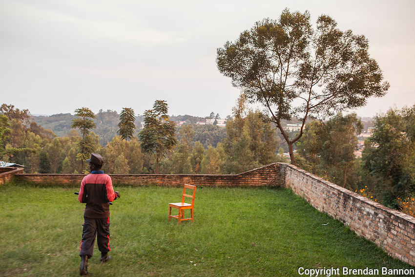 """When I'm working I sit in the chair and I can see above and below the property from there. So if there are robbers I can see around me and I can cacth them."" - Gilbert Gatete, security guard in church compound in Butare, Rwanda."